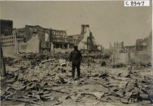 Man Standing on Detroit Rubble